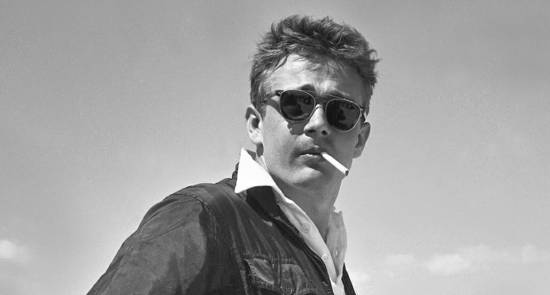 James Dean wearing his preferred style of sunglasses.
