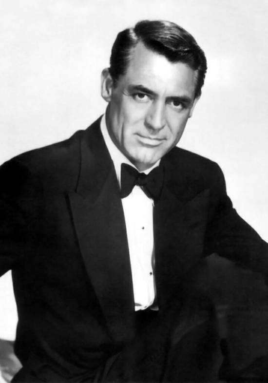 Cary Grant with wide peak lapel tuxedo and butterfly bow tie and two shirt studs