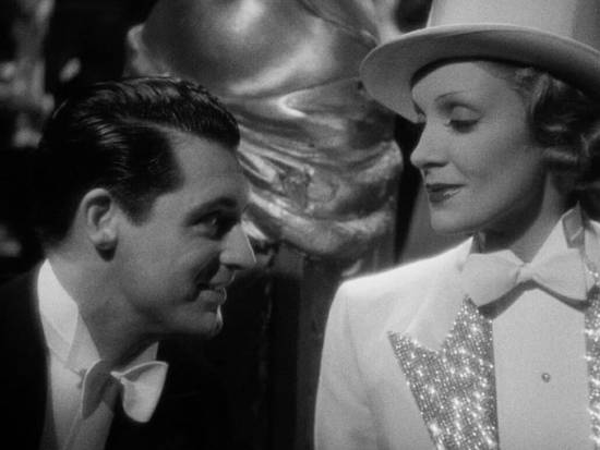 Dietrich in sparkly tailcoat wtih Cary Grant wearing a single end bow tie with his white tie ensemble