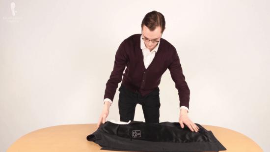 Preston Schlueter folding a jacket