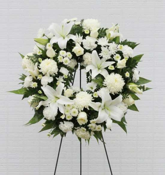 Tasteful Funeral Flowers on a Stand