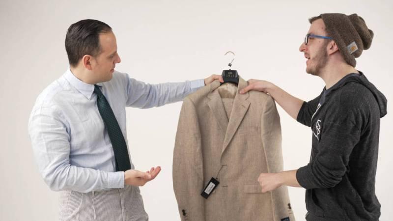 Raphael handing over his unused suit to Chris