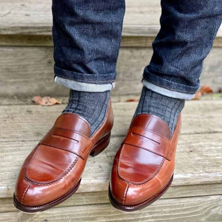 grey socks brown loafers denim