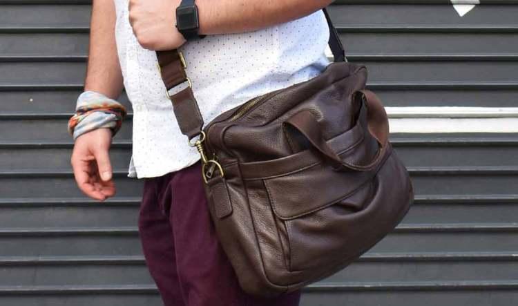daniels briefcase over shoulder closeup