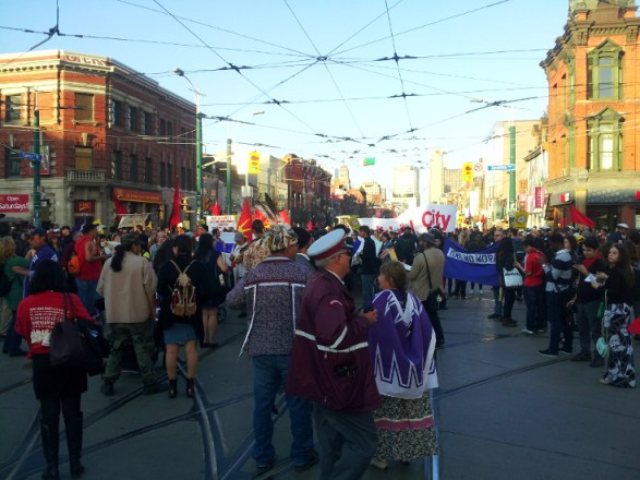 Blocking the Spadina/Queen intersection at rush hour: The radical's strange