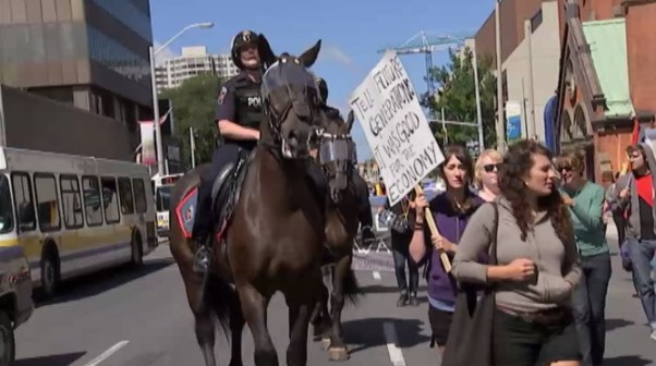 Hamilton mounted police pushing the crowd back...