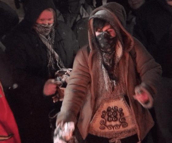 Swamp Line 9 arrestee Trish Mills & Sierra Club exec Chelsea Flook feeding the fire...