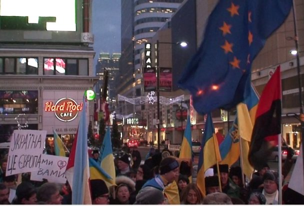 EU and XXX flags at Toronto's Dundas Square in December