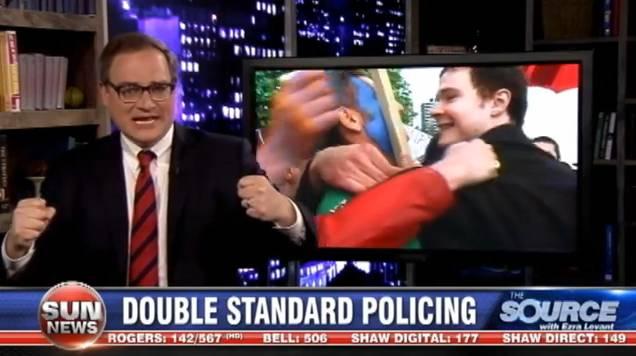 Chris Waddell mobbing Ezra Levant.