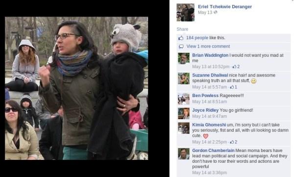 Conference organizer Eriel Deranger waving her fist...