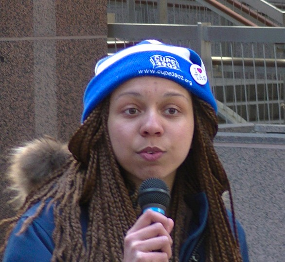 The emcee proudly wore her CUPE 3903 hat...