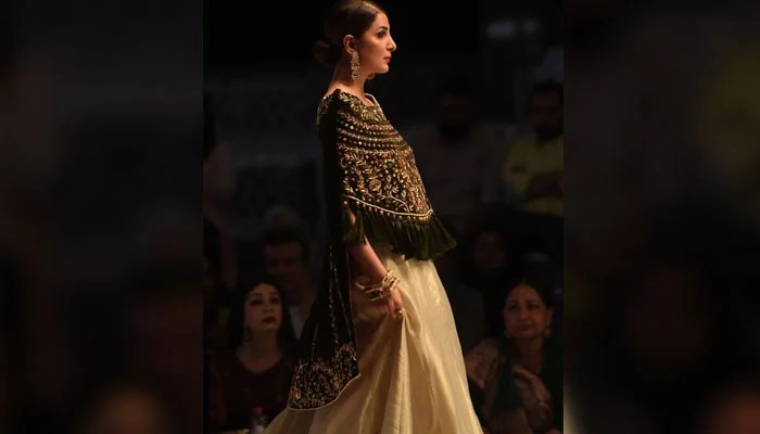 Model walks in designer Obaid Sheikh's creation. Photo: AFP