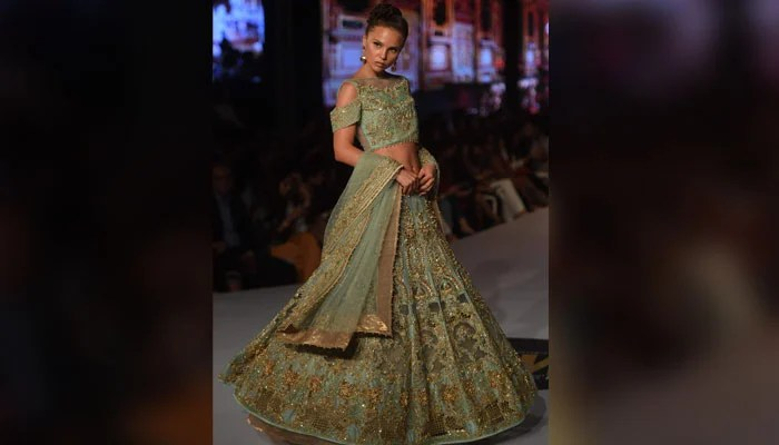 A model wears dress designed by Erum Khan. Photo: AFP