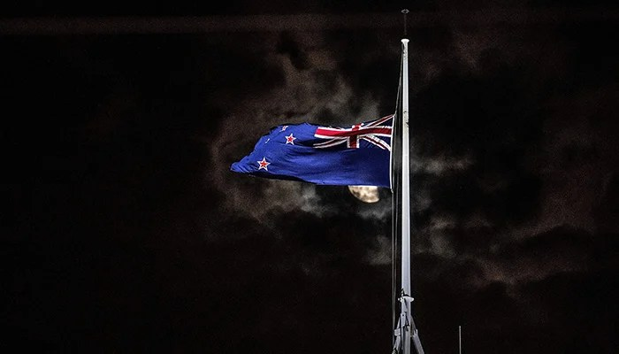 The New Zealand national flag is flown at half-mast on a Parliament building in Wellington on March 15, 2019, after a shooting incident in Christchurch.  PHOTO: AFP