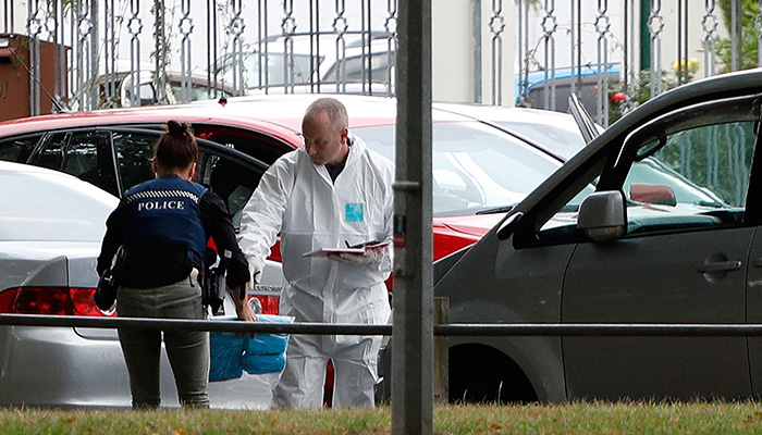 A forensic official works at the Masjid al Noor mosque after a shooting incident in Christchurch. PHOTO: AFP