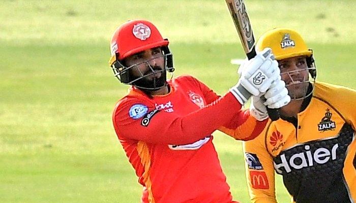 Pakistani batsman Asif Ali hits the ball for a massive six as Kamran Akmal looks on. Photo: Twitter