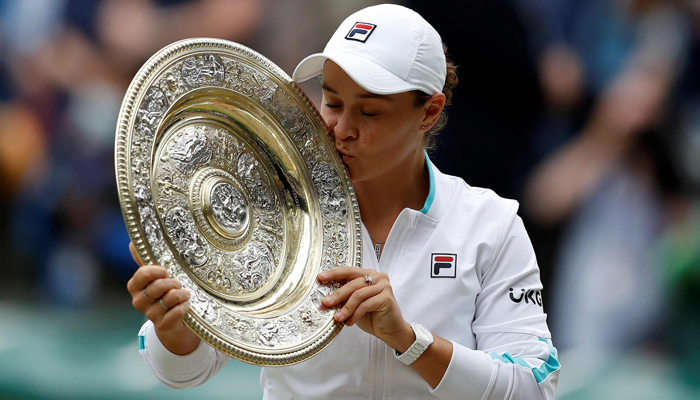 Australias Ashleigh Barty kisses the winners Venus Rosewater Dish trophy after winning her womens singles match against Czech Republics Karolina Pliskova on the twelfth day of the 2021 Wimbledon Championships at The All England Tennis Club in Wimbledon, southwest London, on July 10, 2021. Photo: AFP