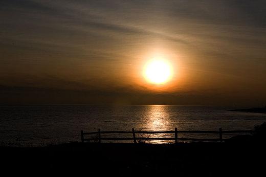 stratford-sunset-through-split-rail-fence.jpg