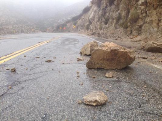 boulder on road