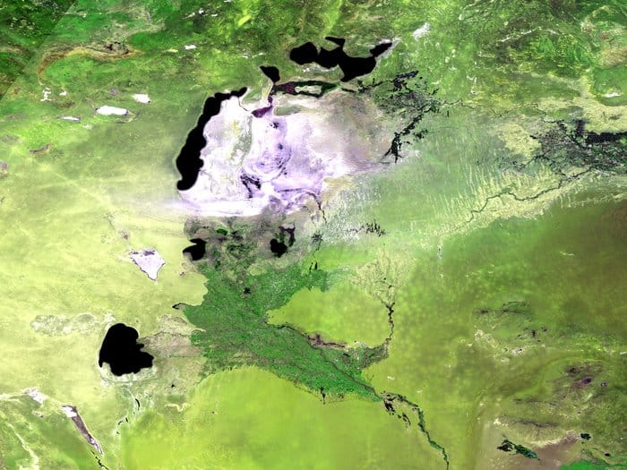 Acquired on May 13, 2014, the 300 m-resolution Proba-V image depicts the white salt terrain left behind by the southern Aral Sea receding, now called the Aral Karakum Desert. The greenery to the south is cultivated land irrigated by the Amu Darya river.