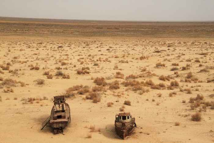 Ghost ships at the former shore of the Aral Sea in Moynaq, Uzbekistan. Photo: Sebastian Kluger.