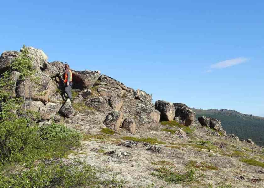 A geologists takes rock samples on the eastern Seward Peninsula in Arkansas.  Photo: Susan Karl, USGS. Public domain