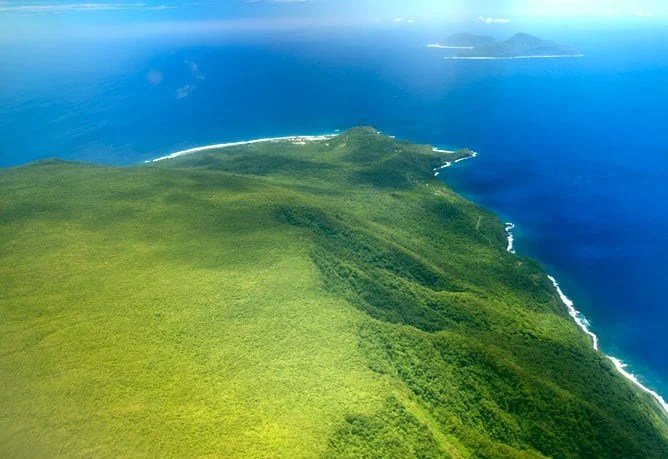 View of the Manu'a Islands with the volcanic islands of Ofu and Olosega (background), and Ta'u (foreground). Image, NPS, public domain