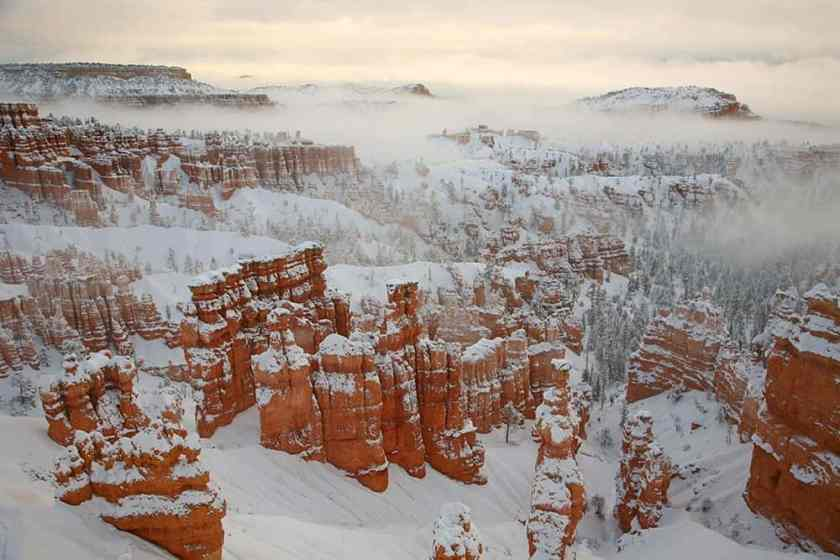 Snow and fog cover the hoodoos at Bryce Canyon main amphitheater. Photo: Bryce Canyon NPS, public domain.