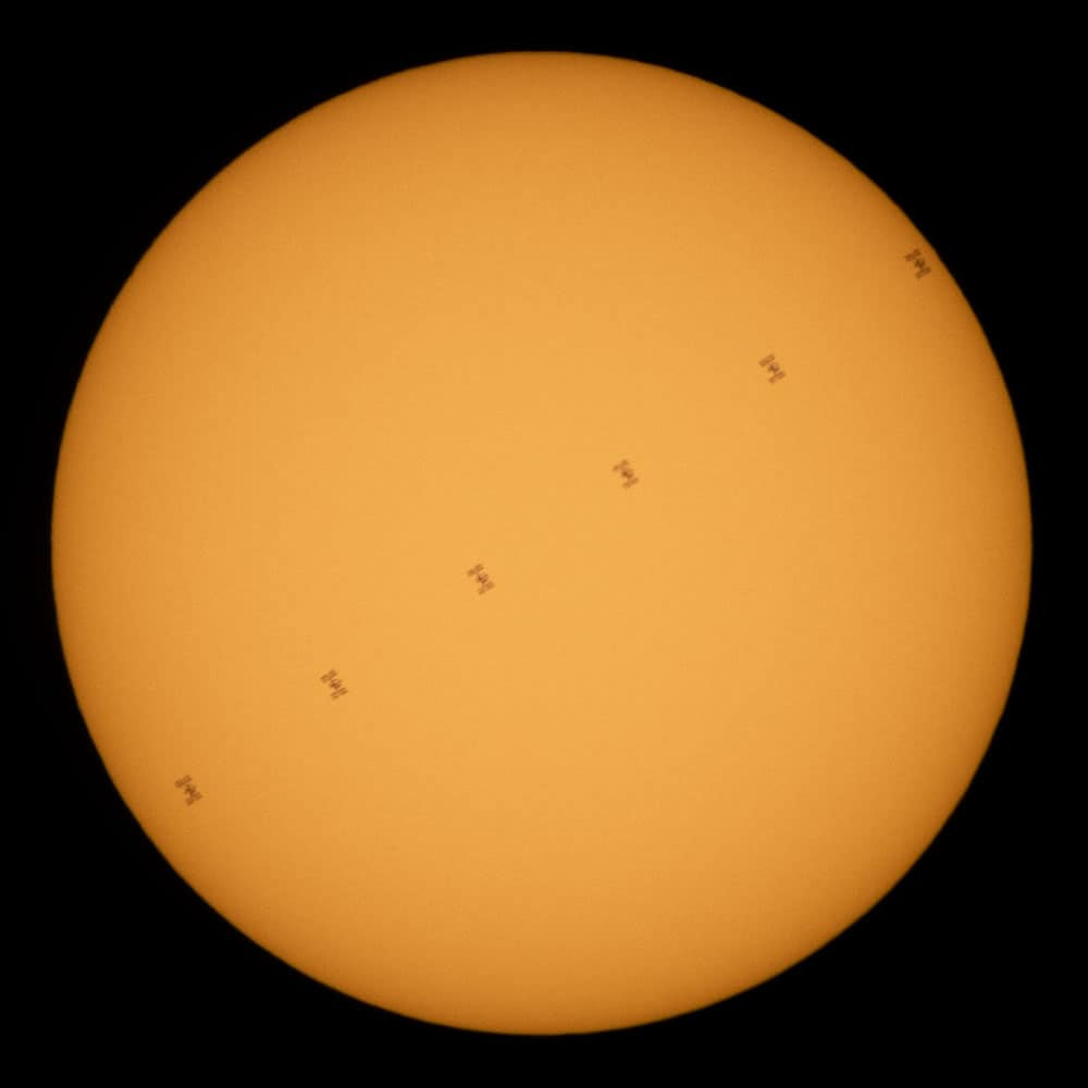 A time-lapse photograph shows the ISS in six frames as it traverses the sun. Photo: Joel Kowsky, NASA, public domain.
