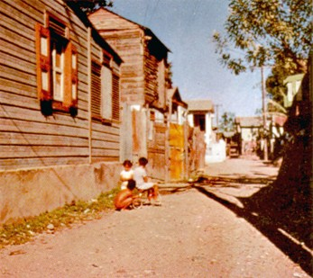 Crowded, small wooden houses such as these are today being rapidly torn down in all Puerto Rican cities, and replaced with modern, sanitary, fireproof houses of concrete.