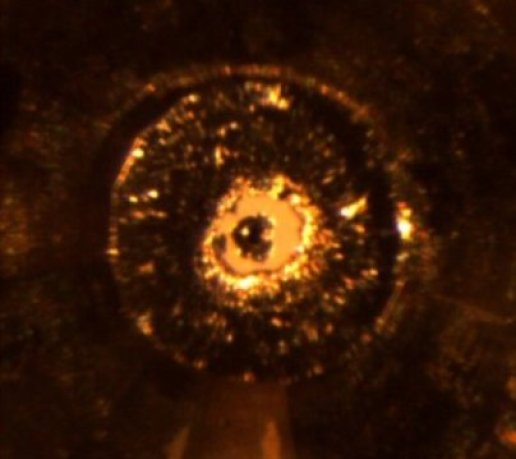 An international team working at the Advanced Photon Source at Argonne National Laboratory has devised a method for achieving static pressures vastly higher than any previously reached. Above: an image of a diamond anvil cell inside the pressure chamber. Traditionally, a diamond anvil cell works like a vice that squeezes the sample between two single-crystal diamonds to produce extreme pressure. In the new device, a miniscule ball of nano-crystalline diamonds sits atop each single-crystal diamond. As the diamonds are squeezed together, the load is transferred from the larger diamond to the nano-ball. This causes the nano-diamond balls to compress and actually get harder, allowing them to both generate and withstand extreme pressures. Credit: Image via Dubrovinskaia et al./Science