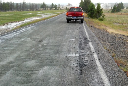 I drove over a part of the Fire Hole Lake Drive that was repaired due to melted asphalt last Sunday, soon after the road was reopened.  The damaged road section is now graveled. Note the absence of steam rising from the road surface - even though it was cool and rainy that day.