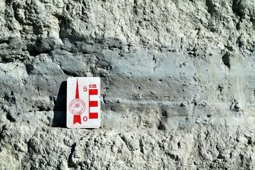 Gray tuff found below calcic paleosol stacks.