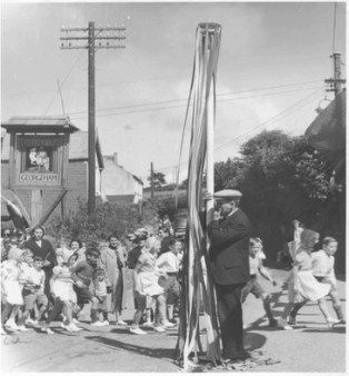 May Pole Dancing in 1941. Tony Fletcher is in the last couple, leading is Geoff Lang and Pat Kift. Local Blacksmith is holding pole.