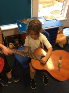 We loved playing the guitar in the music corner