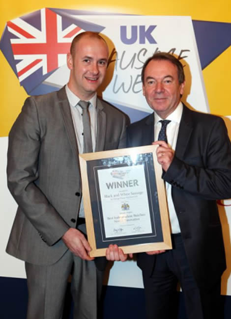 Alex Daley receives his UK Sausage Week award from presenter Eric Knowles