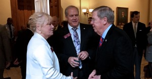 Sen, Johnny Isakson greets a constituent at the Georgia Capitol last month. Photo: Jon Richards