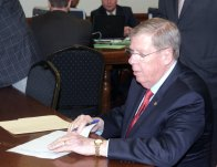 Senator Johnny Isakson finishes up paperwork at qualifying. He will be challenged (so far) by Derrick Grayson in the primary, and James Knox in the general election.