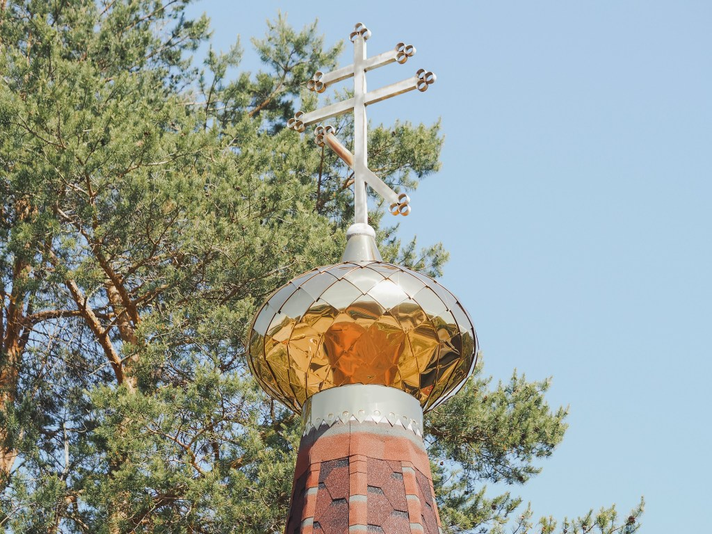 Wooden chuch gold dome Svirstroy, russia