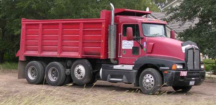 """Triaxle dump truck 2005-10-06.km"". Licensed under Creative Commons Attribution-Share Alike 3.0 via Wikimedia Commons - http://commons.wikimedia.org/wiki/File:Triaxle_dump_truck_2005-10-06.km.jpg#mediaviewer/File:Triaxle_dump_truck_2005-10-06.km.jpg"
