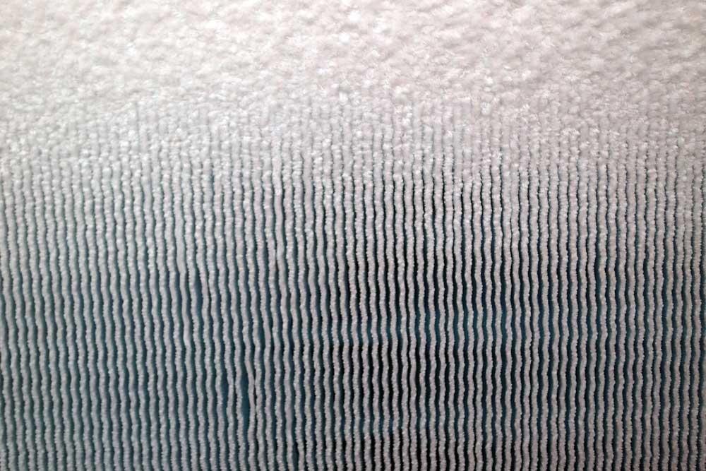 evaporatore ricoperto parzialmente di brina durante funzionamento invernale. Pompa di calore aria-acqua IVT AirX 90