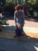 Mommy helping Aubrey with her first steps