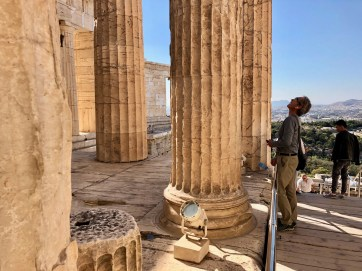 At the entrance of the Propylaea (main entry). To the left behind the columns is the Temple of Athena Nike.