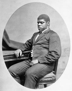 Blind Tom seated in 1880.