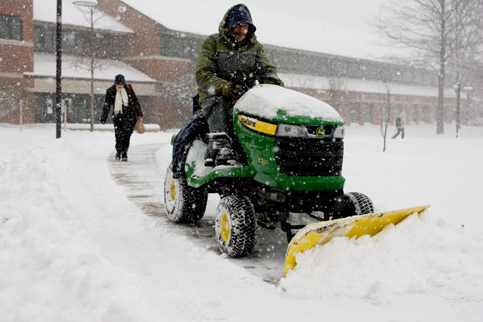 Honorable Mention Feature - Ray Holtmann plows the sidewalk March 4 around the Quad just before Webster University closed for the day. Holtmann has been out plowing since 6 a.m. and is going to keep plowing until he gets called in for the night. He said he would begin plowing again at 6 a.m. the next day and have the sidewalks cleared by 8 a.m. to keep it safe for students.