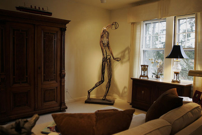 The sitting room in the home of interior designer nEdwin Massie icludes  a life size metal human designed by a local artist. ©2009 Max Gersh | St. Louis Post-Dispatch