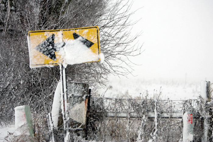 Blowing snow caked onto a street sign near memorial park in New Castle, IN. (C-T photo Max Gersh)