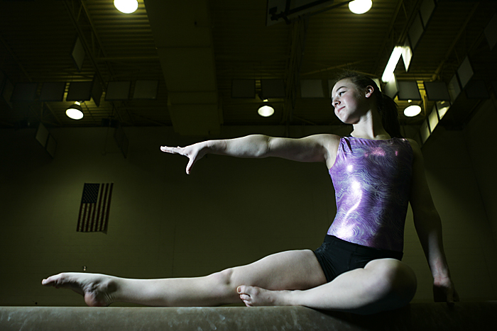Ashlan Millikan poses for a portrait on the beam in New Castle's gymnastics room. (C-T photo Max Gersh) ©2010