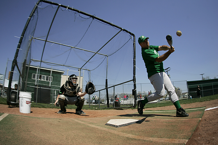 Rick Purvis swings during the New Castle baseball alumni home run derby Saturday afternoon. Purvis graduated in 1998 and scored 12 home runs during his career with the Trojans. (C-T photo Max Gersh)