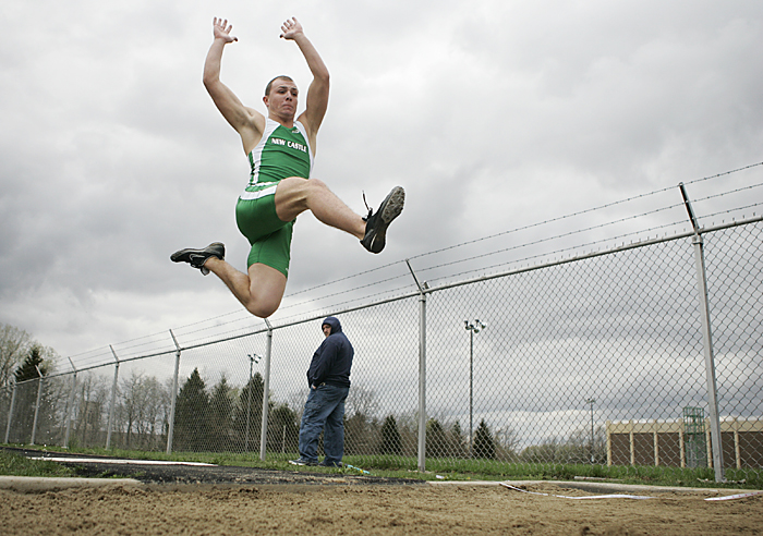 New Castle senior Thatcher Thomas competes in the long jump Thursday afternoon. Thomas jumped 19 feet and 9 inches, securing his victory in the event. (C-T photos Max Gersh)
